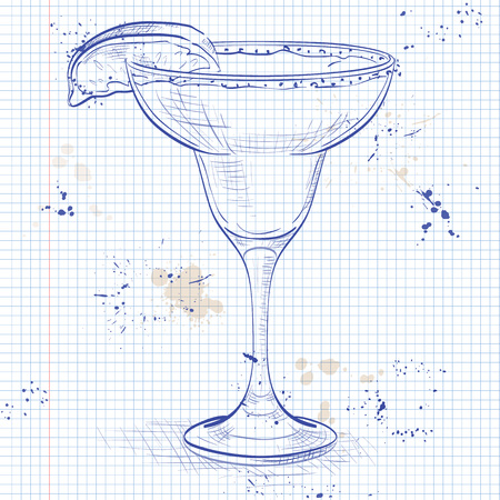 rim: Classic margarita cocktail with lime slice and salty rim on a notebook page
