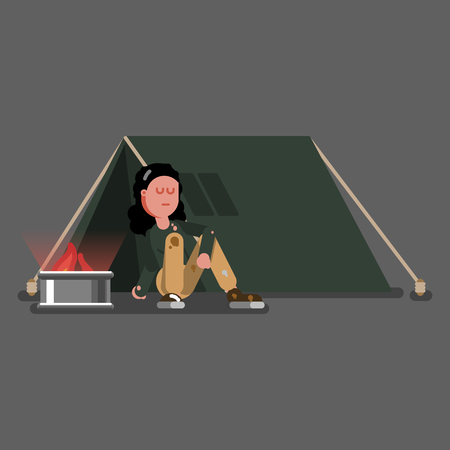 Homeless girl warms herself near tent
