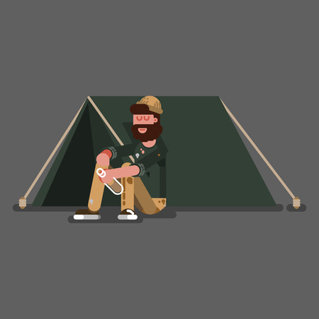 Homeless guy siting on the floor near to a tent.