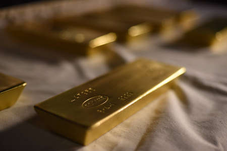 Gold bar from the gold reserve of Russia. Words in the photo: Russia. In the photo there are not translated technical designations. Banco de Imagens
