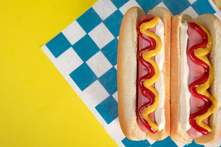 classic hot dogs with ketchup and mustard with space for creators