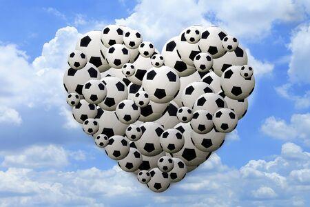 blue ball: Heart shaped football on blue sky background