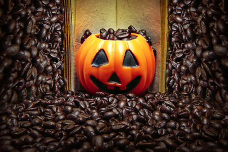 coffe bean: Coffee bean in pumpkin cup on book and coffe bean background