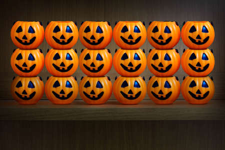 wooden shelf: Halloween pumpkins on wooden shelf