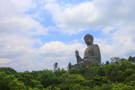 big buddha: Big Buddha on blue sky in sunshine, Hong Kong Stock Photo