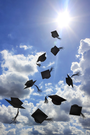 Degree hat throw in sunshine and blue sky background Banco de Imagens