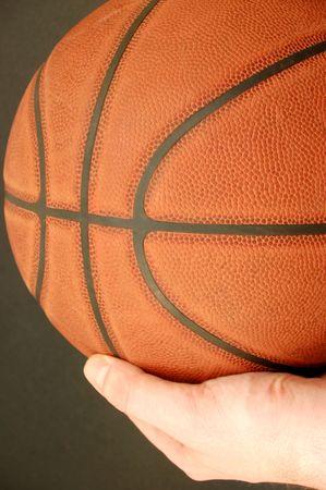 holding basketball photo