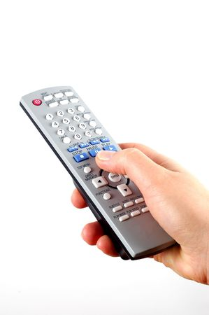 command button: holding remote control Stock Photo