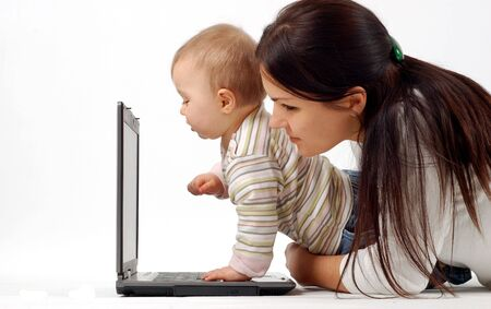 telework: mother and baby with laptop