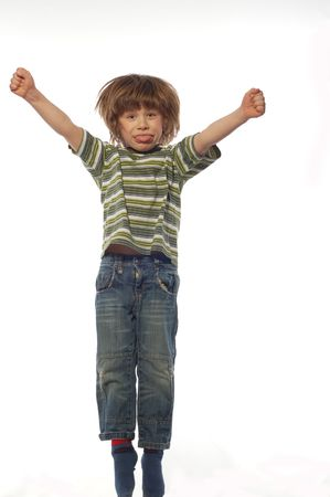 elated: jumping kid Stock Photo