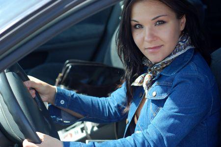 attractive brunette woman happy in new car
