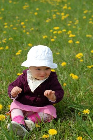 happy baby girl on green meadow photo