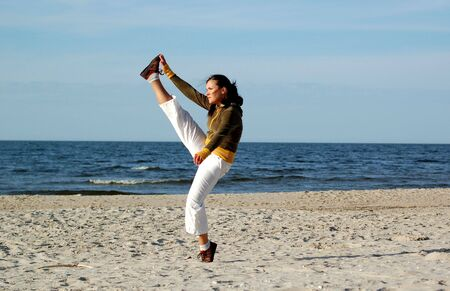 attractive woman doing exercise on the beach Stock Photo - 3071574
