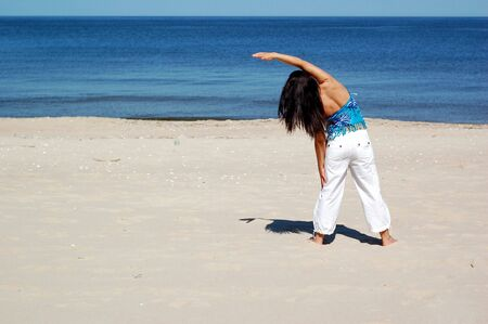 attractive woman doing exercise on the beach Stock Photo - 3071515