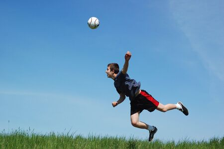 happy football player on sky background Stock Photo - 3096719