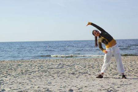 active woman doing exercise on the beach Stock Photo - 3120246