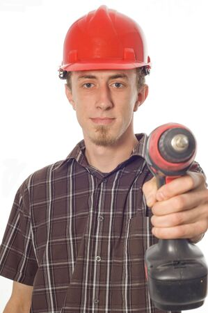 casual worker with drill on white background photo