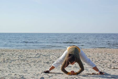 active woman doing exercise on the beach Stock Photo - 3189565