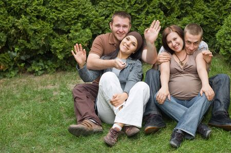 group of happy friends on green grass Stock Photo - 3189597