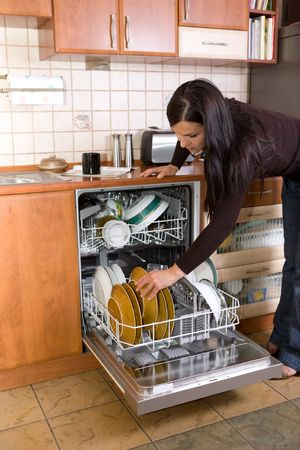 attractive brunette woman cleaning kitchen Stock Photo - 3274530