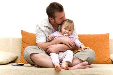 father and  girl playing on sofa