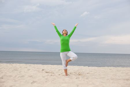 active woman doing exercise on the beach Stock Photo - 3346050