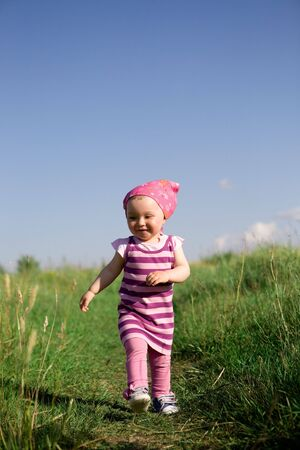happy  girl on green meadow photo