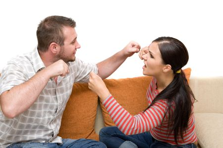 angry couple sitting on sofa Stock Photo - 3346214