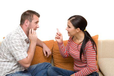 angry couple sitting on sofa