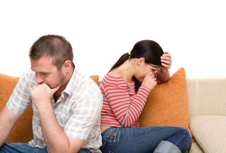 people fighting: angry couple sitting on sofa