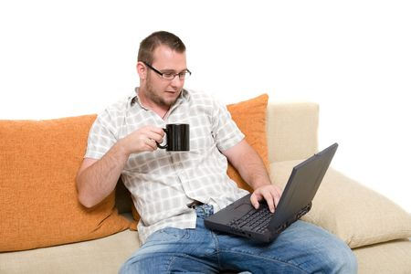 casual man sitting on sofa with laptop