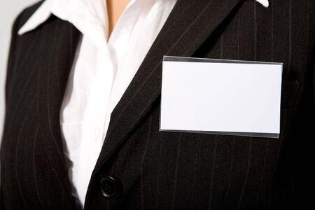 name tags: close up of black suit with id card Stock Photo