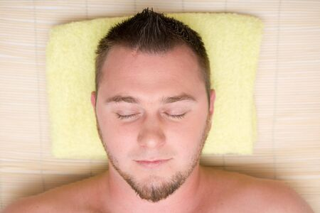 EASE: man relaxing in spa salon