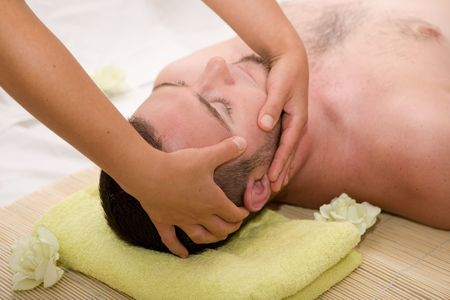 man relaxing in spa salon photo
