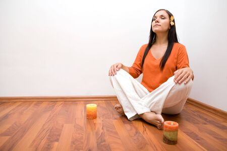 attractive brunette woman meditation at home Stock Photo - 3414860
