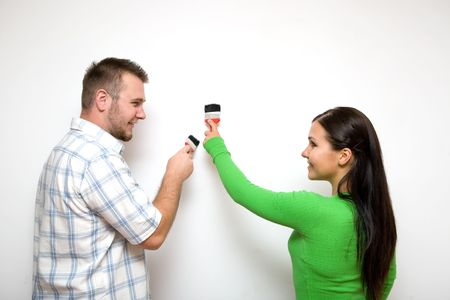 happy casual couple painting wall Stock Photo - 3414906