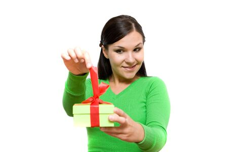 attractive brunette woman holding gift on white background photo