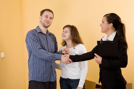 casual and happy couple making transaction  photo