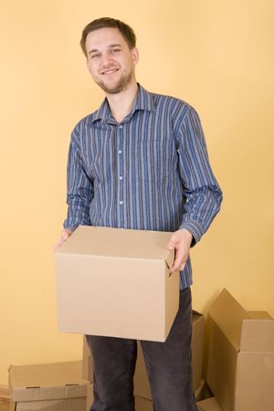 happy man with boxes moving in  photo