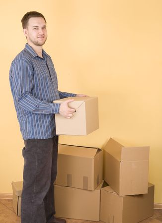 happy man with boxes moving in Stock Photo - 3629001