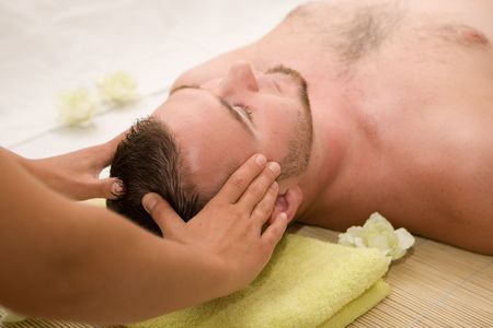happy man relaxing in spa salon Stock Photo