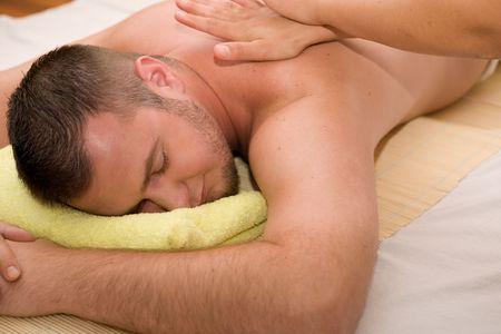 happy man relaxing in spa salon Stock Photo