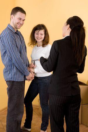 casual happy couple making transaction photo