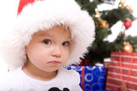 cute  girl over christmas tree photo