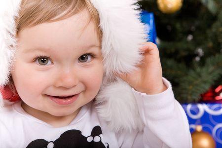 cute  girl over christmas tree Stock Photo