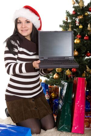 attractive brunette woman happy over christmas tree photo