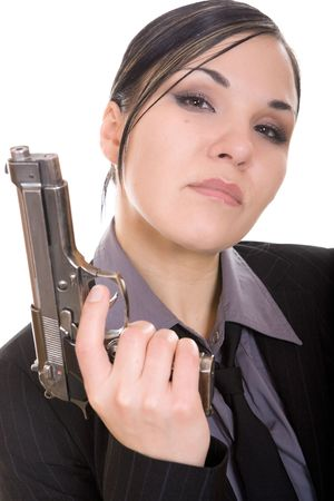 attractive brunette woman with gun on white background photo