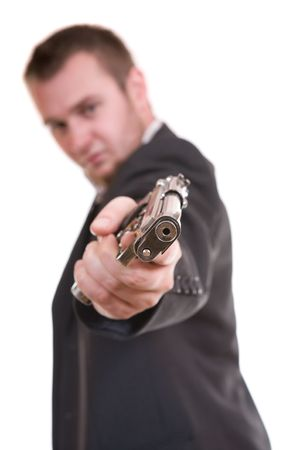 violence and trigger: elegant gangster isolated on white background Stock Photo