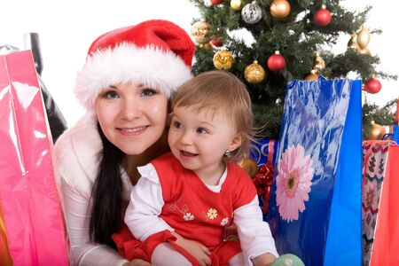 happy mother and daughter over christmas tree photo