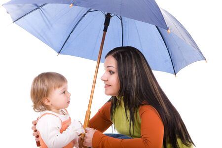 mother and daughter protecting by umbrella. over white background photo